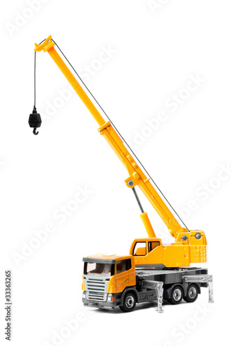 Leinwandbild Motiv toy truck crane isolated over white backgroung