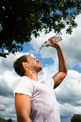 sportsman refreshing himself with a bottle of water