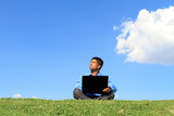 businessman with laptop on the grass