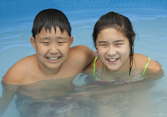 Boy and Girl in a Swimming Pool