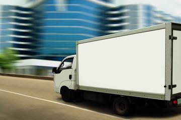 Fast delivering van on blurred modern street.