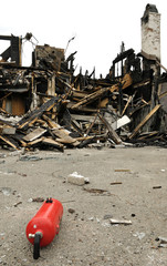 Demolished house after fire accident