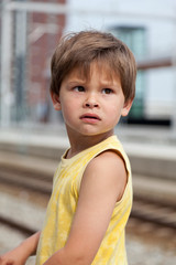 Portrait of young boy at train station