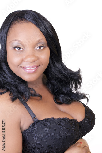 Young black pregnant woman in bra smiling
