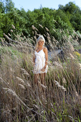 girl are standing in dry grass