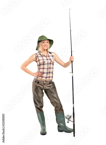 Full length portrait of a blond fisherwoman posing