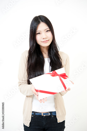 a portrait of beautiful asian woman with gift