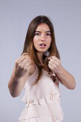 Agressive teenage woman