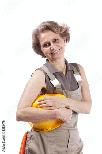 Senior woman with a hardhat
