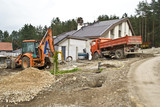 Excavator on site working,road repair,building house poster
