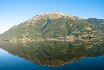 Reflection of a mountain in the Plav Lake, Montenegro