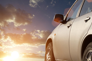 Sunset sky clouds car