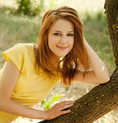 Redhead girl at summer park.