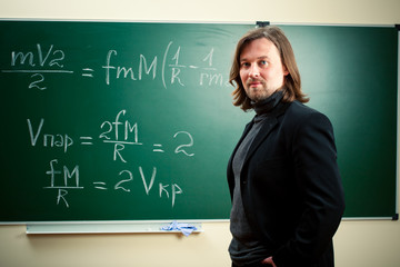 math teacher against the blackboard