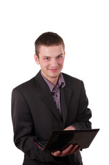 businessman sitting in a jacket with a laptop