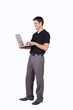 Young man standing and working  on laptop