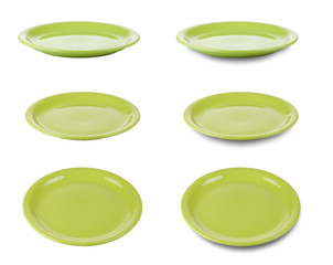 Set of green round plates or dishes isloated on white with clipp
