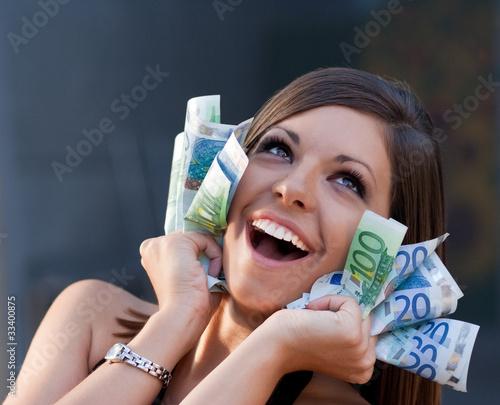 Beautiful ecstatic young woman with Euro bills
