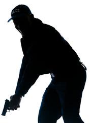 Policeman holding handgun