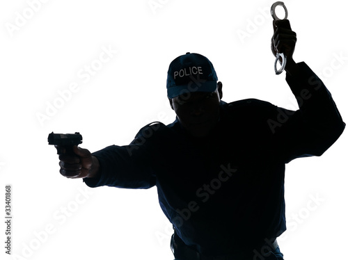 Police officer with handgun and handcuffs
