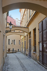 Old narrow street with arches, Prague