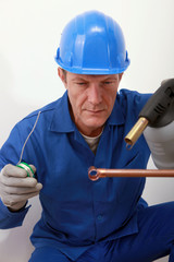 Worker using a blowtorch