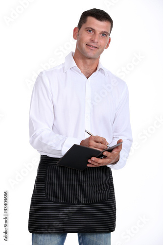 Casual waiter taking an order