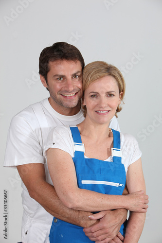 A male and a female artisan holding each other