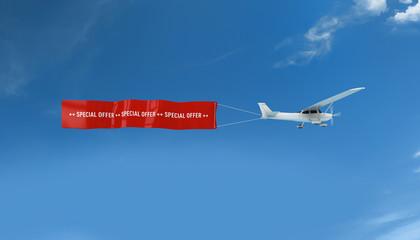 Über den Wolken - Flugzeug mit Banner special offer