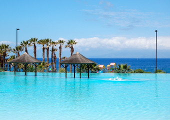 Swimming pool with jacuzzi and beach of luxury hotel, Tenerife i