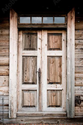 Old door in wooden cottage