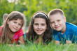 Three kids on the grass