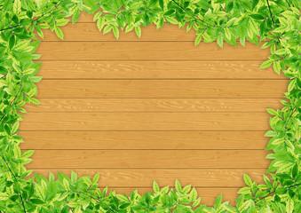 Green leaf border on wood background template