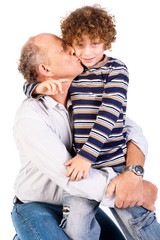 Grandson kissing his grandfather