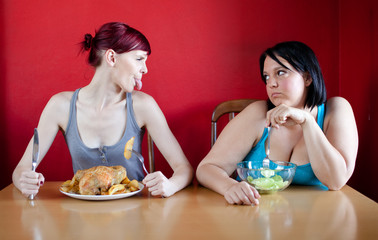 Skinny girl with a whole chicken teasing fat girl who's on a die