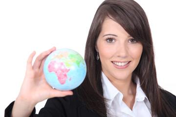 woman holding out world globe