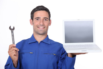 Workman holding laptop