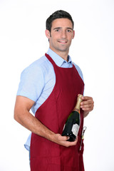 Waiter offering bottle of champagne