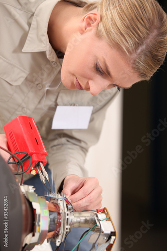 pretty blonde doing repairs
