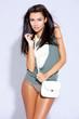 Beautiful female fashion model isolated on white