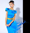 Beautiful female fashion model with paint splash