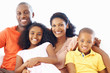 African American family of four smiling together