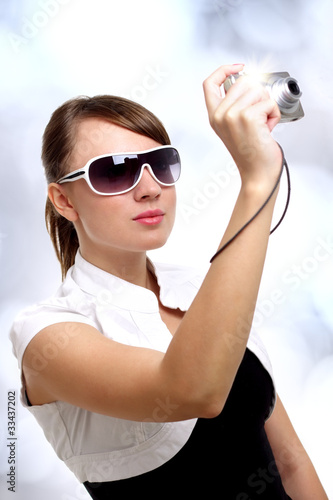 Young stylish woman with a camera