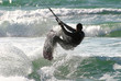 Kitesurfer jumps over the water on Mediterranean Sea.
