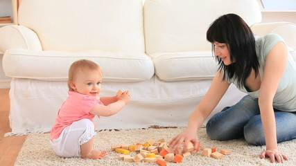 Cute baby playing with her mother