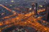 Aerial view of a highway junction at night. Dubai, UAE poster