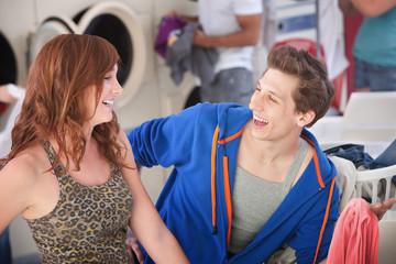 Happy Couple In Laundromat
