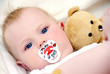 Baby with teddy and pacifier