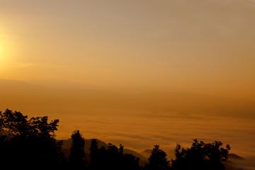 sunrise with fog on the mountain