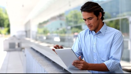 Handsome man using electronic tablet